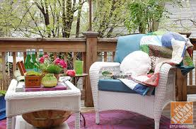 Deck Decorating Ideas: White Wicker Deck Furniture With A Blanket Draped  Across It, And