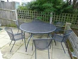 large round metal garden table and 6