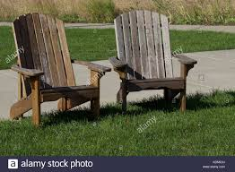 muskoka chairs for sale in parry sound. adirondack chairs in interesting display on grassy lawn - stock image muskoka for sale parry sound p