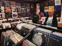 a customer looks through the selection of vinyl als at the sound garden photo by