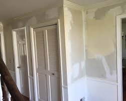 stripping wallpaper with a clothes steamer