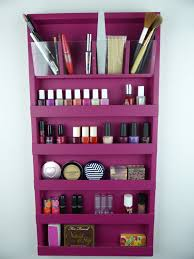 Beautiful wall rack organizer for your makeup, your nail polishes or both  of them! A top row with four clear pencil/brushes holders and five