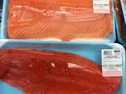 do you really know what you re eating costco whole at costco whole in hackensack on monday comparing the natural color of wild copper river sockeye salmon bottom and artificially colored farmed
