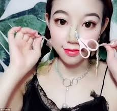 she applied tape on her cheeks and a fake nose to make her features more prominent