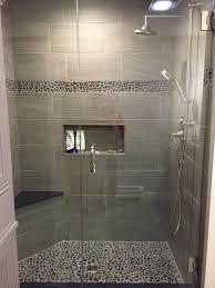 Large charcoal black pebble tile border shower accent.  https://www.pebbletileshop.com/gallery/Charcoal-Black-Pebble-Tile-Border- Shower-Accent.html#