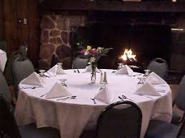 the banquet center at deer run golf club offers a gorgeous view of the golf course in a warm atmosphere that includes a hardwood dance floor fireplace and