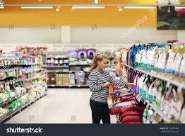Grocery Store Product List Woman Shopping Supermarket Reading Product Information Stock Photo