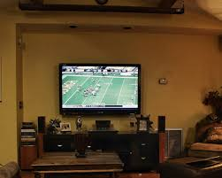 Projectors Vs Tvs Should You Ditch Your Flat Screen For A