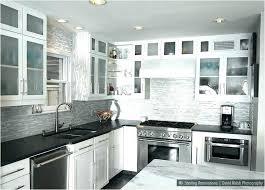 white cabinets black kitchen with dark brown granite countertops