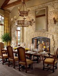 tuscan inspired home on the aspen mountains dining room stone walls chandelier prefer hard floor no carpet dream home