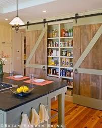 love the barn doors pantry behind barn doors great for a narrow kitchen with little storage and theres s no e for things to get shoved far in the