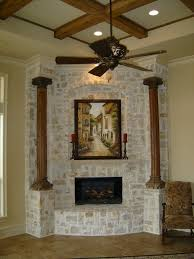 corner stone fireplace accent wall with pillars