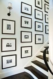 kaufman residence decorated by phoebe howard framed card pictures on stairs