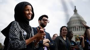 jeremy slevin center standing next to ilhan omar left at a protest