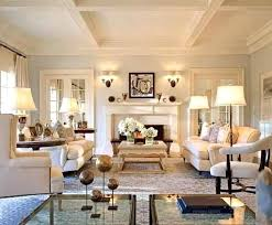 gray and cream traditional living room with pale blue gray walls grey rug cream couch