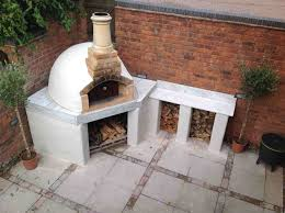 breathtaking outdoor wood fired oven burning pizza plans clay bbq combo