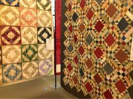backdoorquilts: Indiana Heritage Quilt Show & Wendy Hodina's scrap quilt at right also uses lots of fabrics. We love the  warn tones and contrast between the darks and soft tans. Adamdwight.com