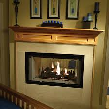see through traditional wood fireplace