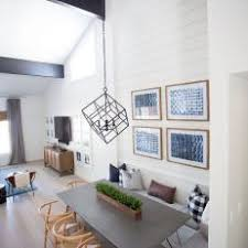 Aerial Dining Room View Featuring Cube Chandelier Over Sleek Gray Dining  Table With Built In Bench Seating