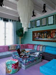 Large Boho Chic Living Room With Turquoise Walls And Colorful Upholstery
