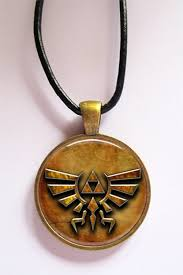 legend of zelda hylian crest pendant in bronze and leather cord