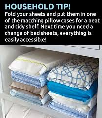 Fold up a set of sheets, put them inside matching pillowcase. Keeps all your