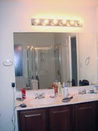 height of light fixture over bathroom vanity. latest bathroom light fixture height above mirror of over vanity a