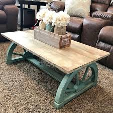 Chalk painted vintage wagon wheel coffee table | rustic home funiture