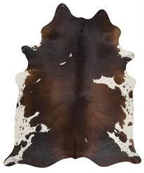 chocolate brown and white cowhide rug 2508321 weddbook white cowhide rug in living room