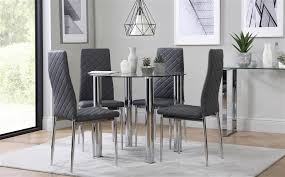 gallery solar round chrome and glass dining table with 4 renzo grey chairs