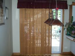 beige curtain on wide white stained wooden frame sliding glass door