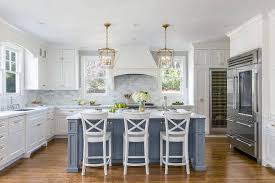 white kitchen cabinets. White Kitchen With Stacked Cabinets And Grey Island.