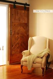 hardware to hang a diy wood barn door using trolley tracks and hangers the