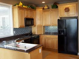 kitchen floor tiles small space:  interior light brown wooden kitchen cabinet with storage plus white sink and black counter