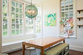 turquoise beaded orb chandelier over dining table