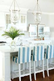 white beach house decor coastal kitchen with bell jar lantern pendants strip white marble white beach