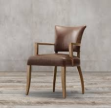 rh s adèle leather armchair our reion of a classic french dining chair cossets in comfort with its gently flared back and padded seat