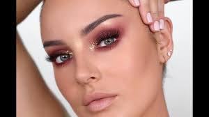 wearable editorial makeup burgundy eyes gold flakes
