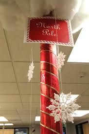 images work christmas decorating. North Pole Decorating Ideas We Could Do Something Like This With One Of The Square Work Christmas Party Ideasoffice Office Decorations Pictures Images