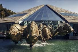 in 2014 the red bull headquarters in fuschl am see were completed by the additional installation of 14 bronze bulls austria view red bull