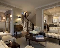 Traditional Living Room Design Living Room Gray Recliners White Shelves Gray Sofa Brown Chairs