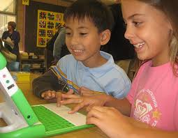 Third graders in D.J. Perry's class at Kellogg School get their first look at the XO laptop offered by One Laptop Per Child — and appear to like what they ... - 1215-Laptops-540