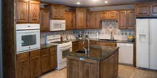 kitchens with dark cabinets and white appliances h