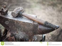 blacksmith anvil and hammer. royalty-free stock photo. download hammer on blacksmith anvil and g