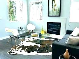 s white faux cowhide rug and silver