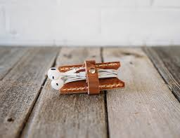 leather bound earbud holders