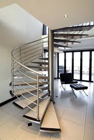 Decorations:Outstanding Spiral Staircase Designs With Silver Stainless  Steel Fence And Relaxing Black Chair Idea