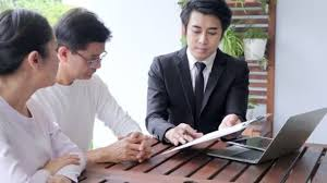 Financial Advisor Retirement Asian Senior Couple Sitting With Financial Advisor Looking At Papers And About To Sign Retirement Preparation Concept