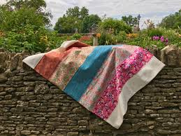 to add a bit of bohemian to your home try making your own throw blanket this wide strip quilt is uncomplicated in construction but allows the bold prints