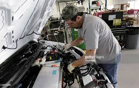 ford transit connect electric van assembly at am general factory joe emery installs the main wiring harness on a ford motor co transit connect electric